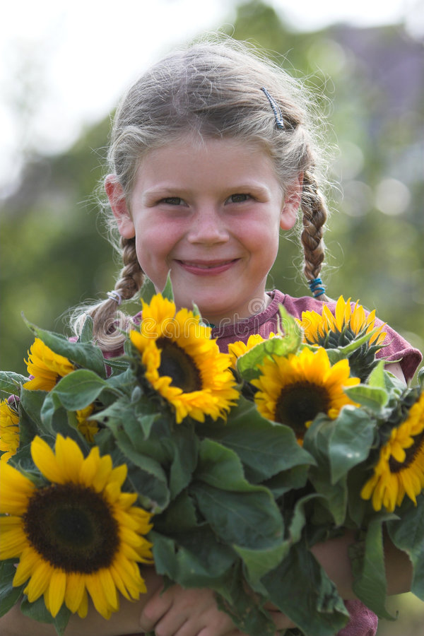 Cute sunflower girl royalty free stock images