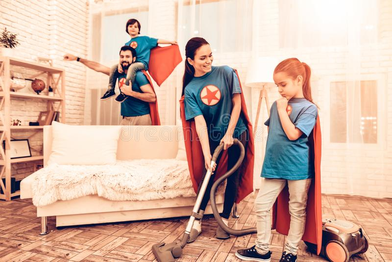 Cute Superhero Family Cleaning House with Kids. Mother with Kids Washing at Home. Cleaning Day Concept. Cosplay Superheroes. Kids Helping House Chores. Parent stock image