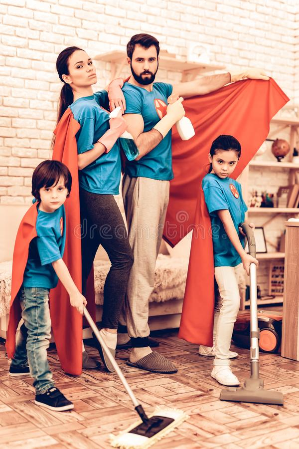 Cute Superhero Family Cleaning House with Kids. Mother with Kids Washing at Home. Cleaning Day Concept. Cosplay Superheroes. Kids Helping House Chores. Parent royalty free stock images