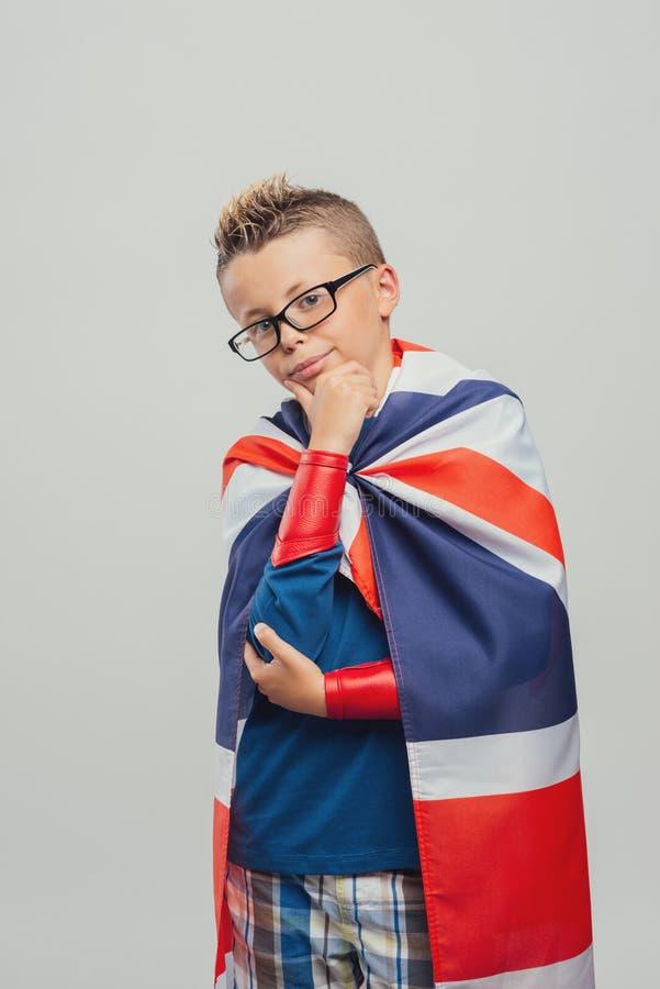 Cute superhero with hand on chin stock photos