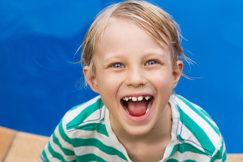 Cute surprised boy next to pool stock image
