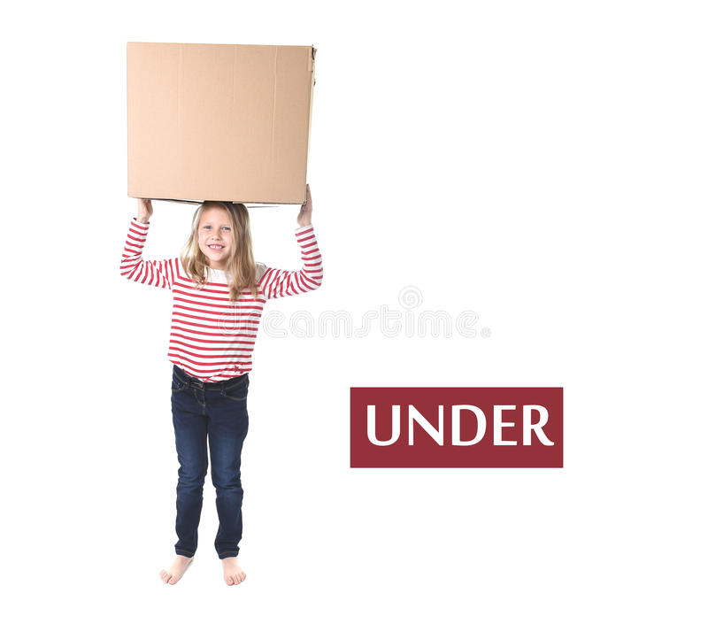 Cute and sweet blond hair child standing under cardboard box learning English card set. Cute and sweet blond hair holding box on her head standing under it stock photo