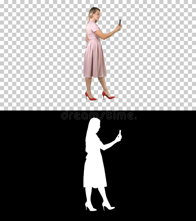 Cute sweet gorgeous nice stunning adorable good-looking good-dressed lady making selfie while walking, Alpha Channel. On Alpha Matte. Full length portrait side royalty free illustration