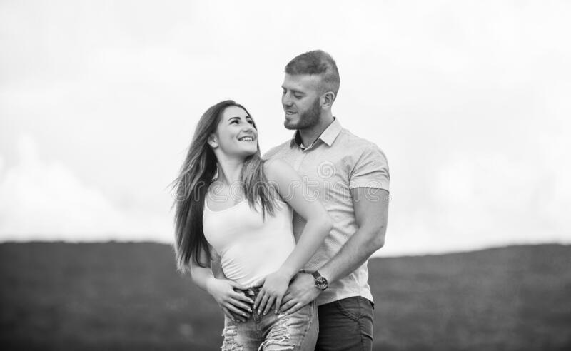 Cute and sweet relationship. Couple in love. Couple goals concept. Man and woman cuddle nature background. Family love. Cute and sweet relationship. Couple in stock photo