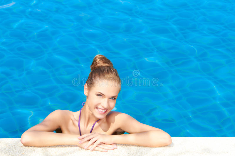 Cute in swimming pool with copy space
