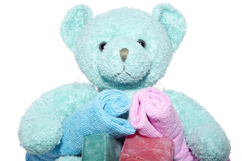 Teddy bear with bars of soap and facecloths royalty free stock images