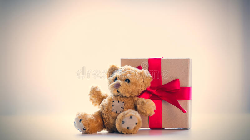 Cute teddy bear and beautiful gift on the wonderful white background royalty free stock photo
