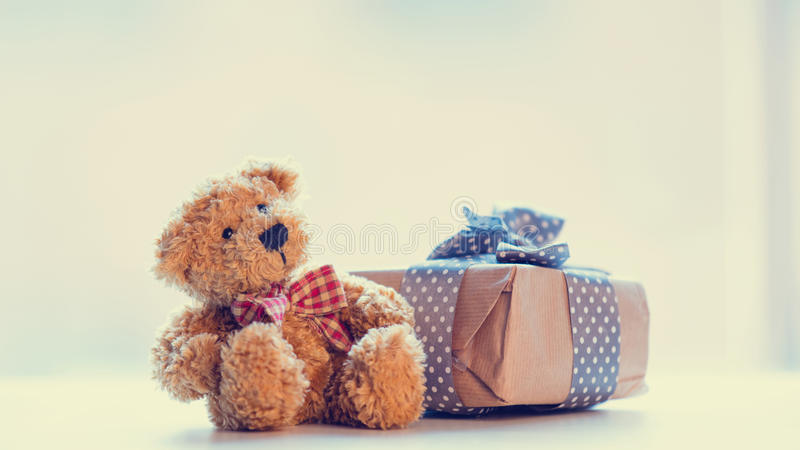 Cute teddy bear and beautiful gift on the wonderful white background stock photo