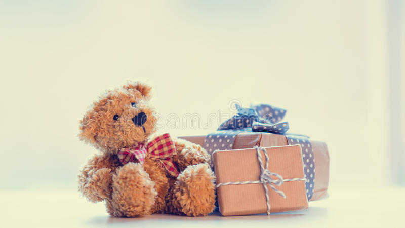Cute teddy bear and beautiful gifts on the wonderful white background stock photo
