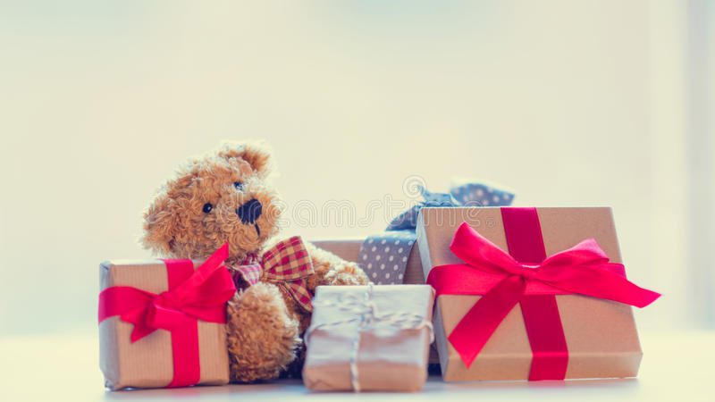 Cute teddy bear and beautiful gifts on the wonderful white background stock photography