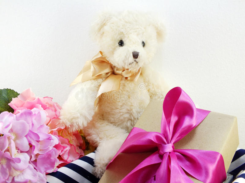 Cute Teddy Bear With Gift And Beautiful Bouquet Flowers Stock Photo ...