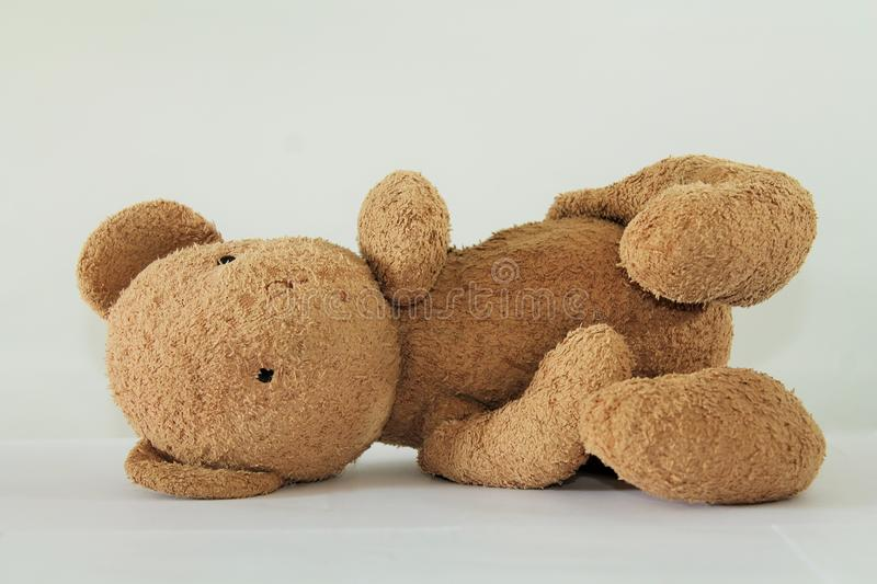 Cute Teddy Bear Lying Down, Isolated on White Backround.  stock photo