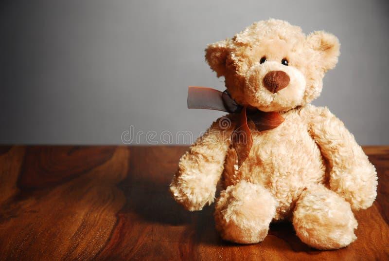 Cute teddy bear on a table royalty free stock photos