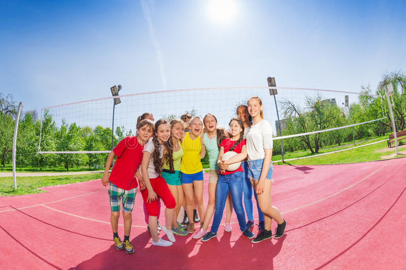 Cute teen boys and girls in volleyball team stock photos