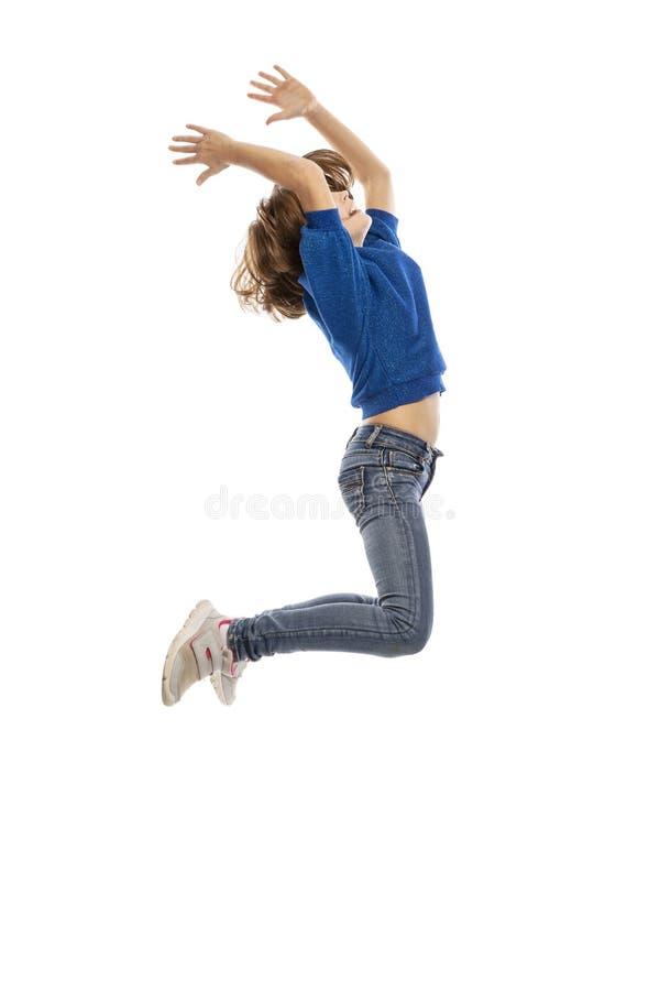 Cute teen girl in a jump stock photos