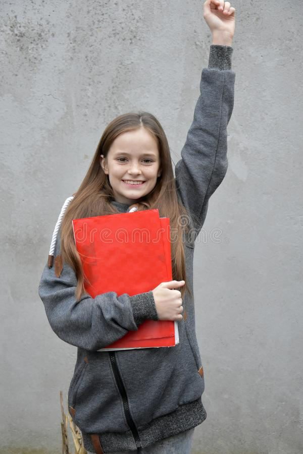 Schoolgirl with exercise books and folders stock images