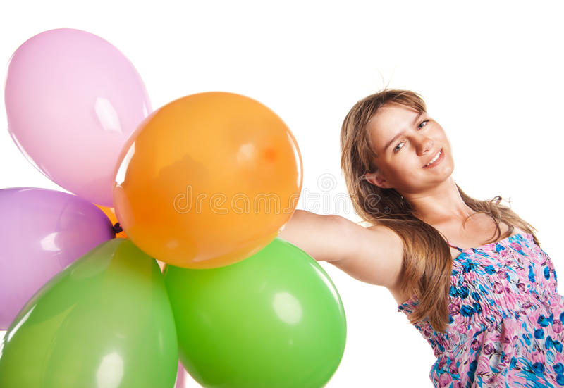 Cute teenage girl holding balloons on white. Portrait of cute teenage emotional girl holding balloons on white studio background royalty free stock image