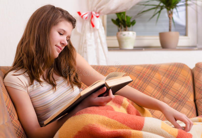 Cute teenage girl reading old book royalty free stock image