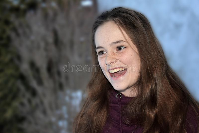 Cute teenage girl screams with joy stock image