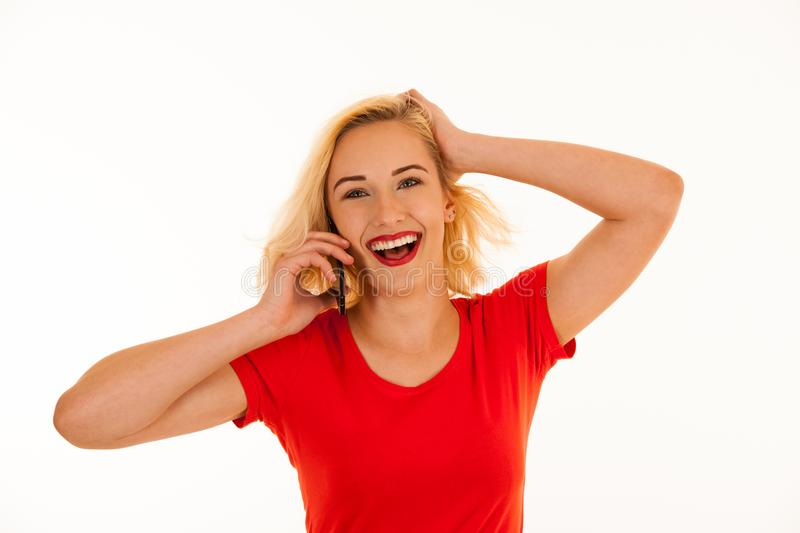 Cute teenage girl talking in smart phone isolated over white background stock images