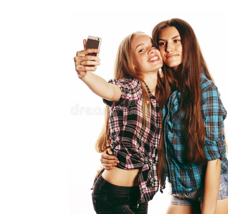 Cute teenage girls making selfie isolated stock photo