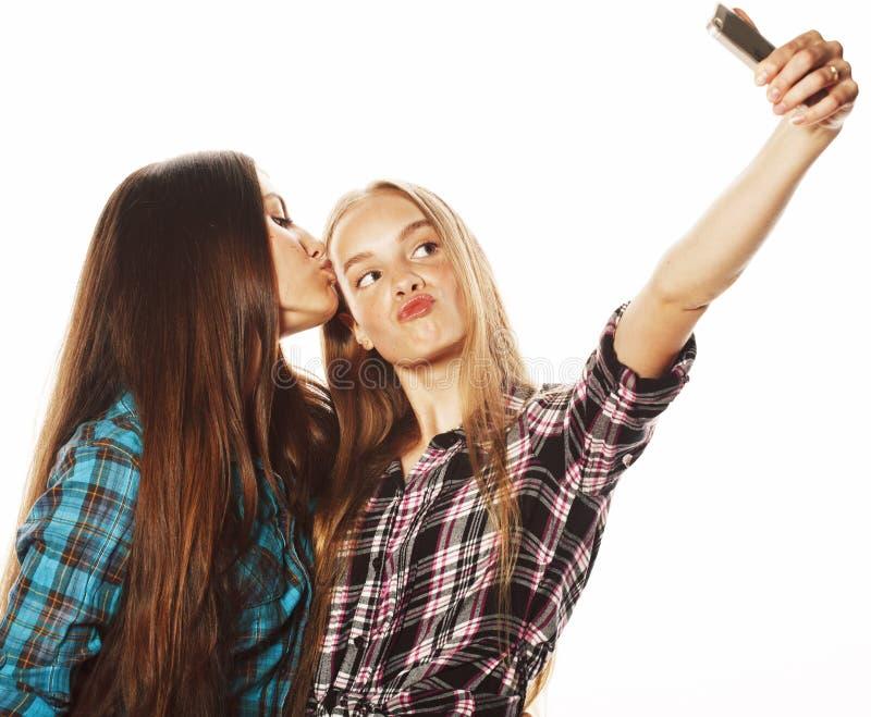Cute teenage girls making selfie isolated stock photos