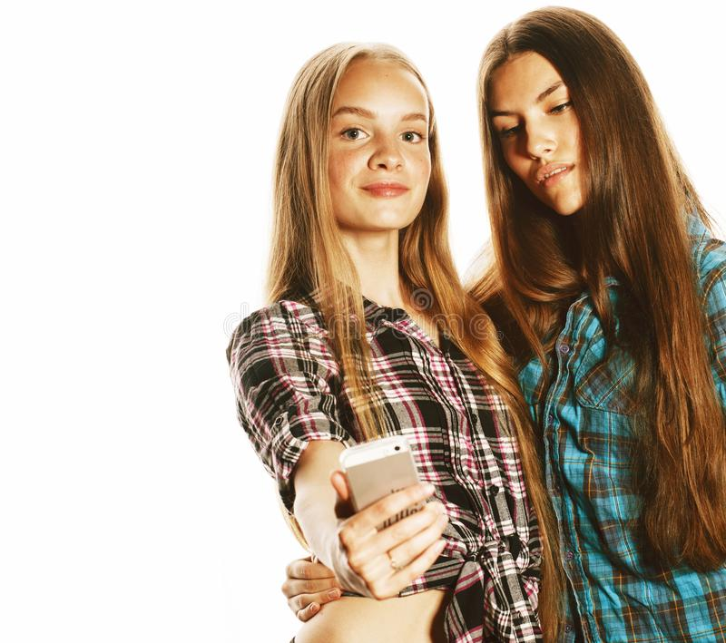 Cute teenage girls making selfie isolated stock photography