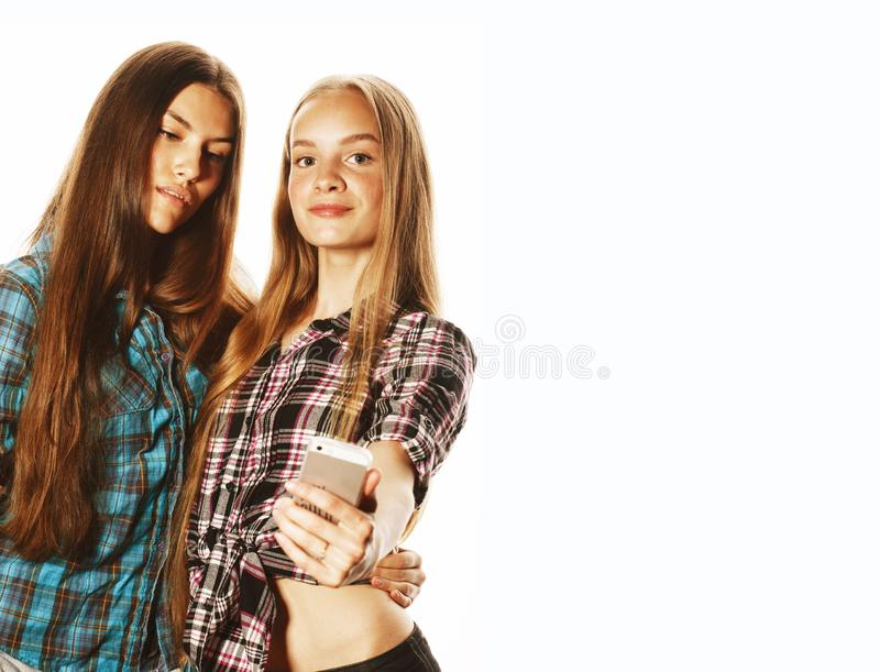 Cute teenage girls making selfie isolated royalty free stock photos