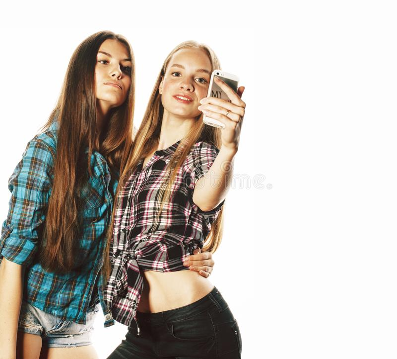 Cute teenage girls making selfie isolated stock photos