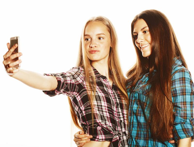 Cute teenage girls making selfie isolated royalty free stock image