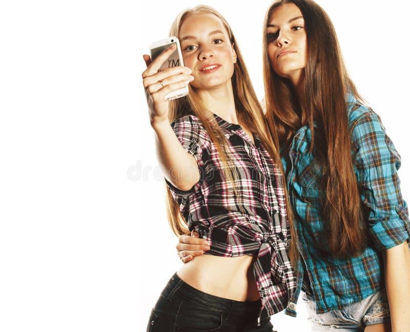 Cute teenage girls making selfie isolated stock photography