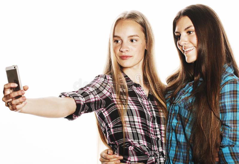 Cute teenage girls making selfie isolated. On white stock images