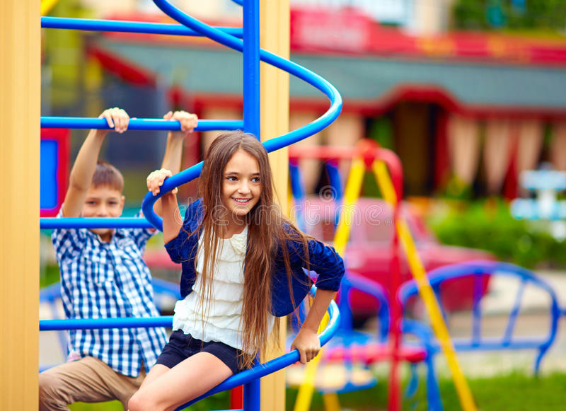 Cute teenage kids having fun on playground stock photo