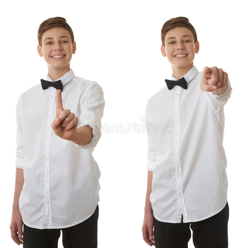 Cute teenager boy over white isolated background. Set of cute teenager boy in white shirt and black bow tie pushing something in front himself over white royalty free stock photography
