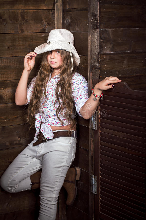 Cute teenager girl in a cowboy hat royalty free stock photo