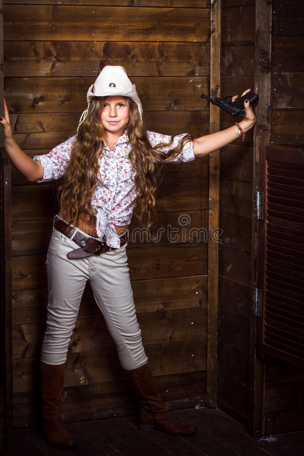 Cute teenager girl in a cowboy hat royalty free stock photos