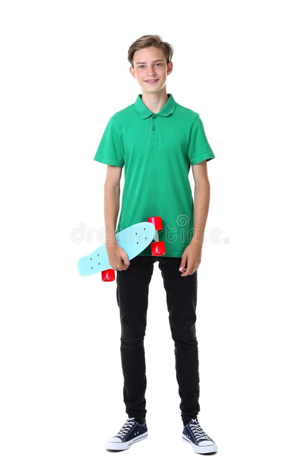 Cute teenager with skateboard. On white background stock photography