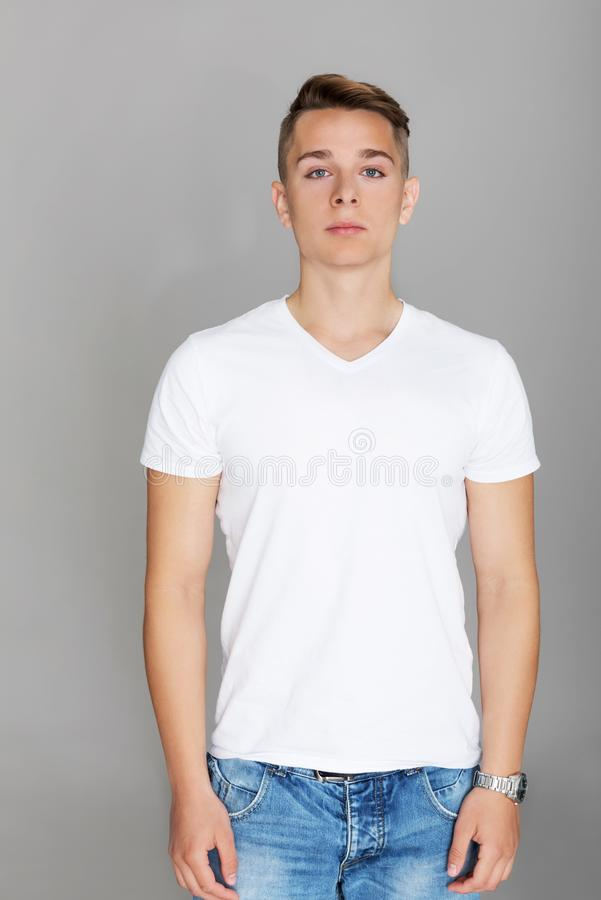 Cute teenager in white t-shirt. The portrait of young cute teenager in white t-shirt stock photography