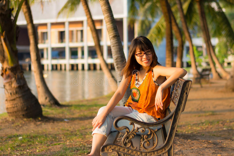 Download Cute Thai Girl Is Relaxing Near The Riverside Stock Image - Image: 29676263