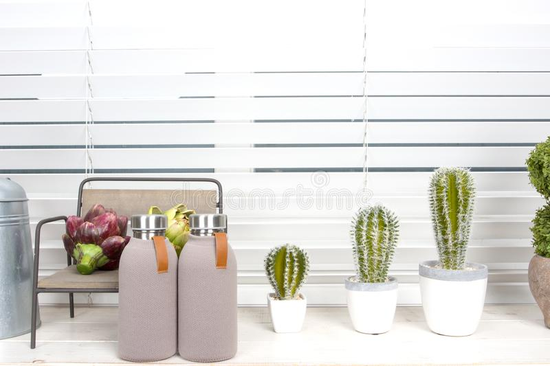 Cute tiny interior pieces and small garden on windowsill. stock images