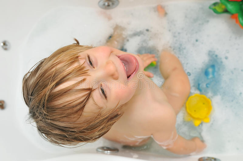 Cute toddler in the bath royalty free stock images