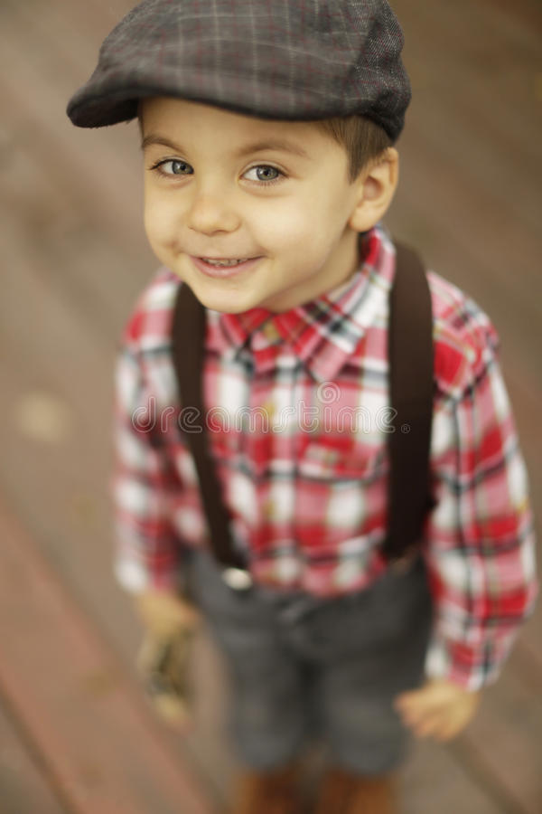 Download Cute Toddler Boy With Beautiful Eyes In Vintage Style Hat Stock Photo