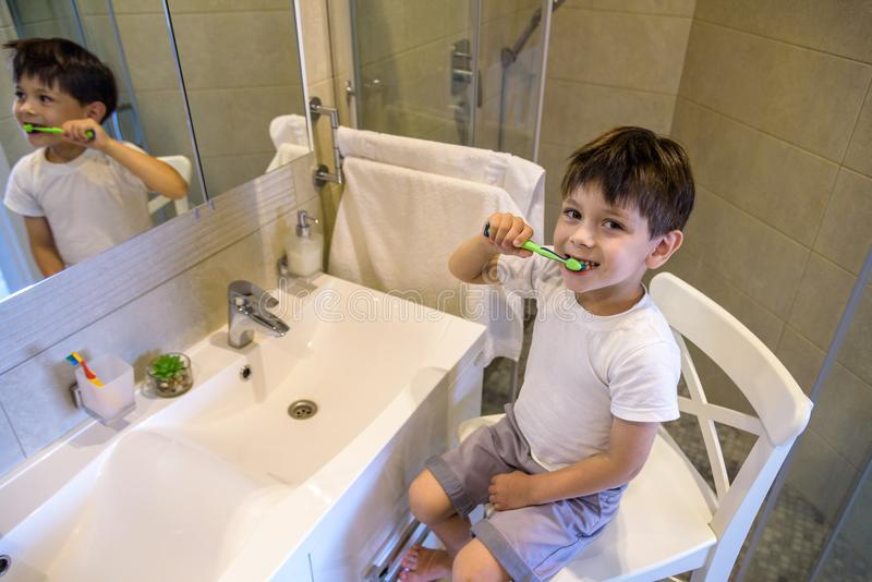 Cute toddler boy brushing teeth. Teeth cleaning, dental care. adorable baby boy washing up stock images