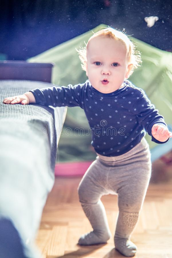 Cute toddler boy in a room posing royalty free stock photo
