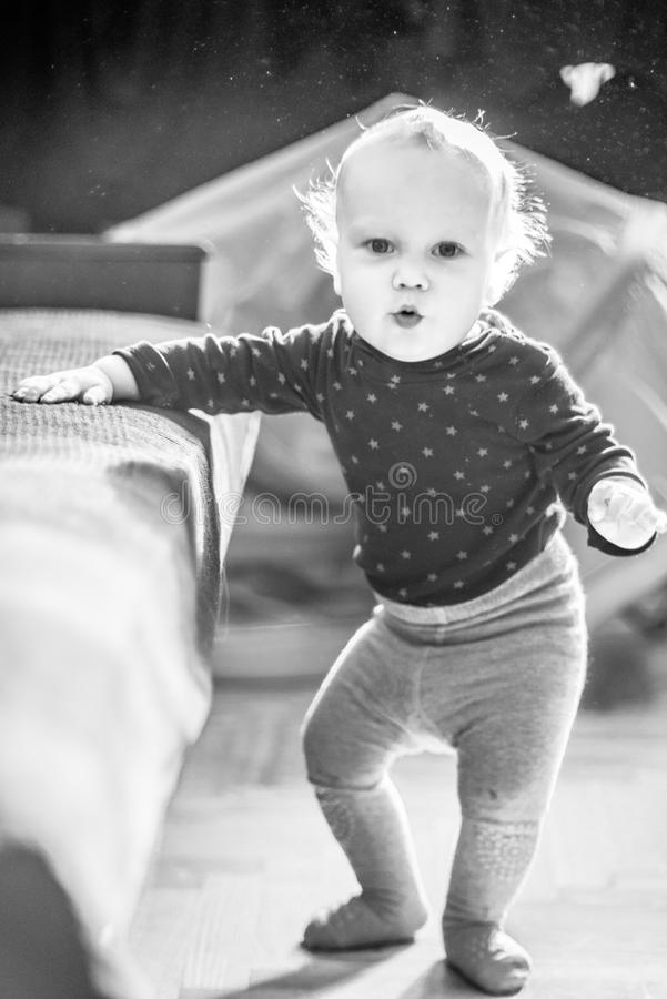 Cute toddler boy in a room posing stock images