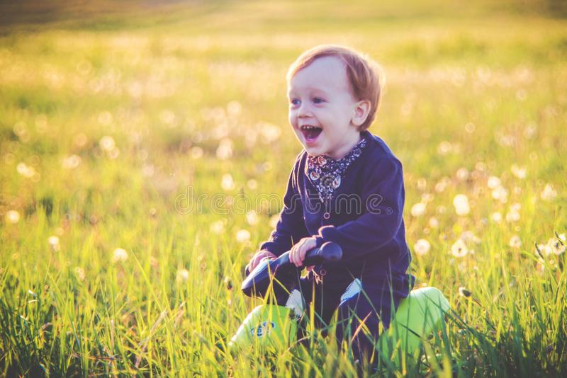 Cute toddler child joyful moments in nature, happy emotion expression stock images