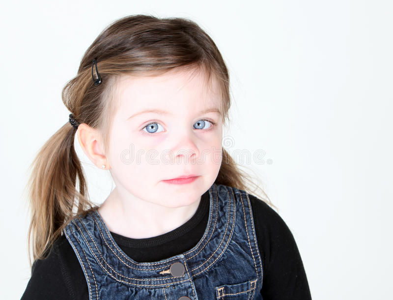 Cute toddler girl looking at camera stock images