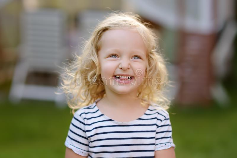Cute toddler girl outdoors portrait in summer day. Smiling and charming child stock images