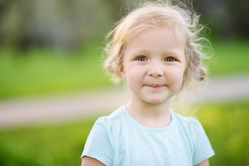 Cute toddler girl outdoors portrait in summer day royalty free stock images
