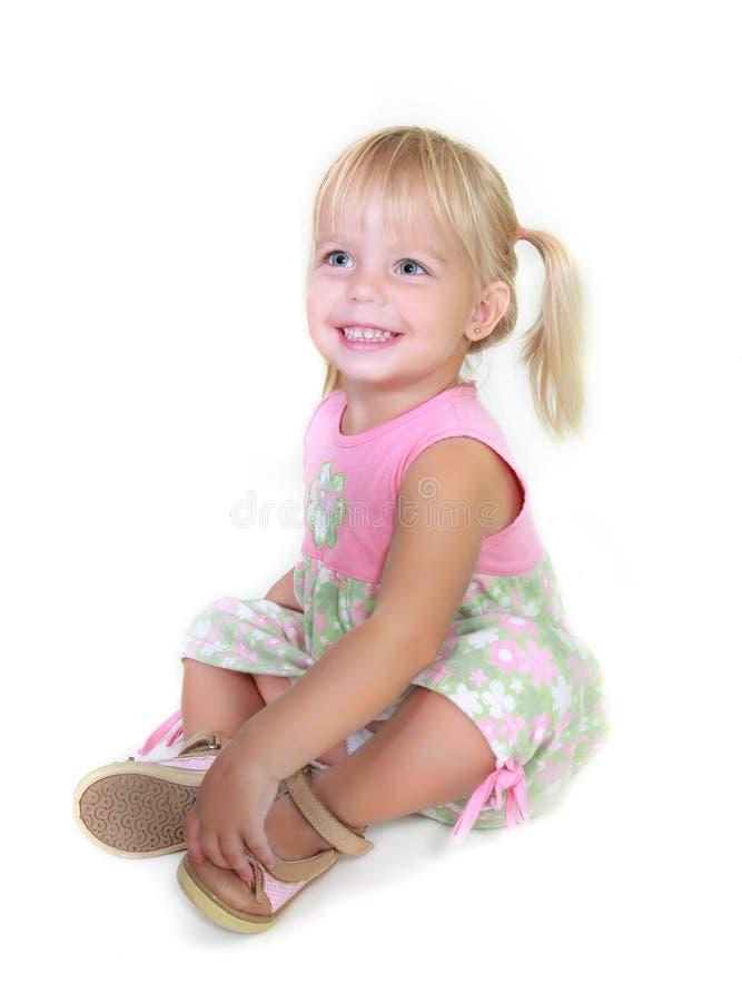Cute toddler girl sitting stock photos